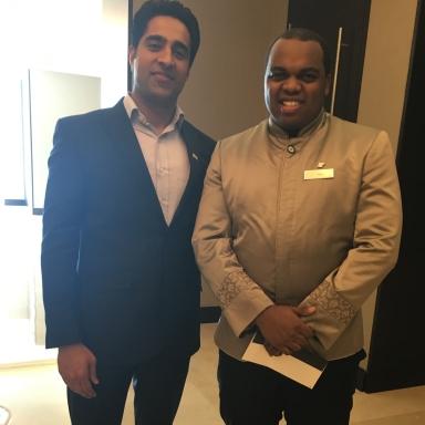 Simerjeet Singh thanks Banquet Associate Lewis at JW Marriott Marquis Dubai